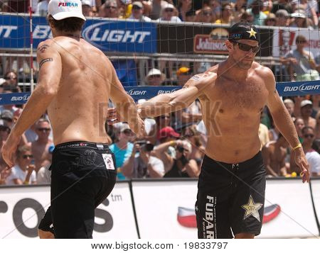 HERMOSA BEACH, CA. - AUGUST 9: Phil Dalhausser and Todd Rogers vs. John Hyden (L) and Sean Scott (R) for the mens final of the AVP Hermosa Beach Open. August 9, 2009 in Hermosa Beach.