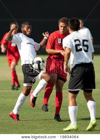 NORTHRIDGE, CA. - AUGUST 28: Joe Franco (L) & Nicholas DeLeon (M) fight for the ball w/ Daniel Yoon (R) for support during the UNLV vs. CSUN pre-season exhibition on August 28, 2009 in Northridge, Ca.