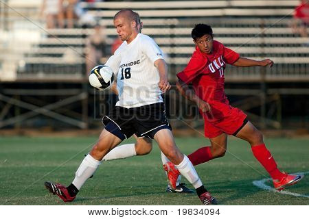 NORTHRIDGE, CA. - AUGUST 28: Jake Troy (L) and Robert Garcia (R) fight for the ball during the UNLV vs. CSUN pre-season exhibition on August 28, 2009 in Northridge, Ca.