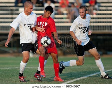 NORTHRIDGE, CA. - AUGUST 28: Jake Troy (L) Robert Garcia (M) and Chad Borak (R) fight for the ball during the UNLV vs. CSUN pre-season exhibition on August 28, 2009 in Northridge, Ca.