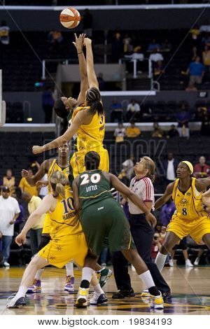 LOS ANGELES, CA. - SEPTEMBER 16: Both teams fighting for the ball after the tip off of the WNBA playoff game of the Sparks vs. Storm on September 16, 2009 in Los Angeles.