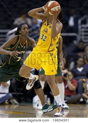 LOS ANGELES, CA. - SEPTEMBER 16: Tina Thompson (R) trying to get past Swin Cash (L) during the WNBA playoff game of the Sparks vs. Storm on September 16, 2009 in Los Angeles.