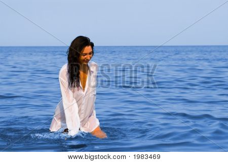 Pretty Young Woman On The Sea