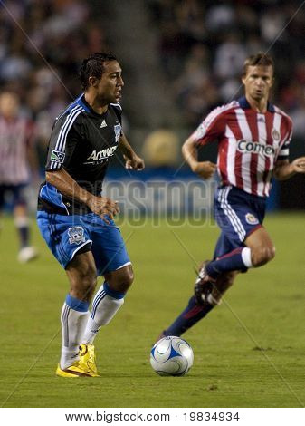 CARSON, CA. - OCTOBER 17: Arturo Alvarez (L) and Jesse Marsch (R) in action  during the Chivas USA vs. San Jose Earthquakes match at the Home Depot Center on October 17, 2009 in Carson.