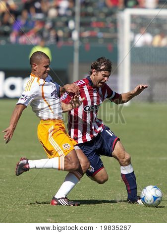 CARSON, CA. - OCTOBER 25: Carey Talley (R) &  Abe Thompson (L) fight for the ball during the Chivas USA vs. Houston Dynamo match on October 25th, 2009 at the Home Depot Center in Carson.