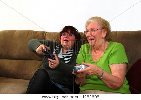 Granddaughter And Grandmother Playing Video Game