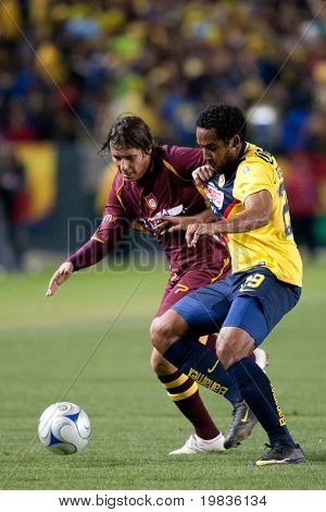 CARSON, CA. - JANUARY 9: Daniel Alcantar (L) & Jean Beausejour (R) fight for the ball during the match of Club America & Estudiantes Tecos at the Home Depot Center January 9, 2010 in Carson, CA.