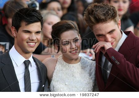 LOS ANGELES, CA. - JUNE 24: Robert Pattinson (R) Kristen Stewart (M) & Taylor Lautner (L) attend The Twilight Saga Eclipse  Los Angeles premiere on June 24th, 2010 at The Nokia Theater in Los Angeles.