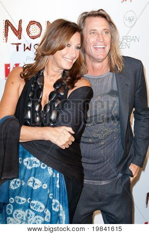 SANTA MONICA, CA. - FEB 22: Donna Karan (L) and Russell James (R) arrive at the Nomad Two Worlds Los Angeles debut gala at 59 Pier Studios West on Feb 22, 2011 in Santa Monica, CA.