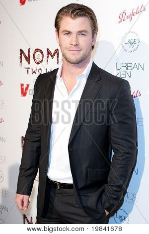 SANTA MONICA, CA. - FEB 22: Australian actor Chris Hemsworth arrives at the Nomad Two Worlds Los Angeles debut gala at 59 Pier Studios West on Feb 22, 2011 in Santa Monica, CA.