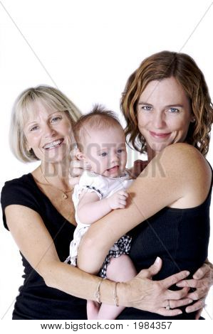 Grandmother Hugging Her Daughter And Granddaughter