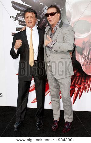 HOLLYWOOD, CA. - AUG 3: Sylvester Stallone (L) and Mickey Rourke (R) arrive at The Expendables Los Angeles premiere at Grauman's Chinese Theater on August 3, 2010 in Hollywood, Ca.