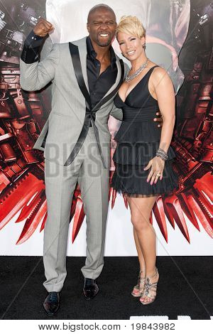 HOLLYWOOD, CA. - AUG 3: Actor Terry Crews (L) and Rebecca Crews (R) arrive at The Expendables Los Angeles premiere at Grauman's Chinese Theater on August 3, 2010 in Hollywood, Ca.