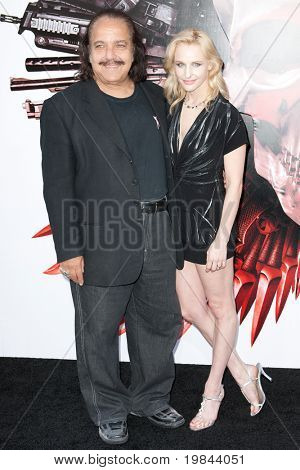 HOLLYWOOD, CA. - AUG 3: Ron Jeremy (L) and guest arrive at The Expendables Los Angeles premiere at Grauman's Chinese Theater on August 3, 2010 in Hollywood, Ca.