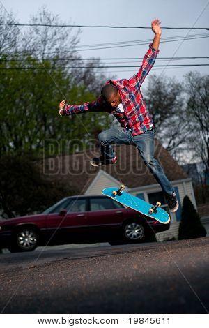 Skateboarder Man Doing A Kick Flip