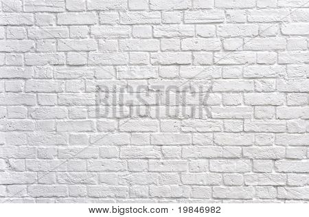 Una pared de ladrillo blanco