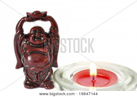 Buddha statue and a candle