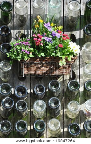 Empty Champagne bottles and flowers