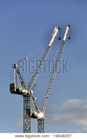Two cranes on construction site