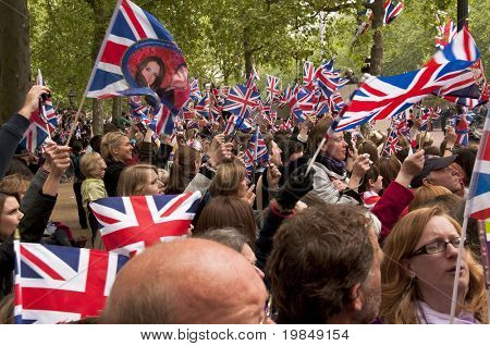 LONDON, UK - APRIL 29: The crowd waving their flags at the wedding of Prince William and Kate Middleton on the Mall, April 29, 2011 in London, United Kingdom