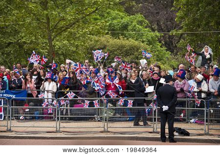 LONDON, UK - APRIL 29: The crowd of spectators on the Mall at Prince William and Kate Middleton wedding, April 29, 2011 in London, United Kingdom