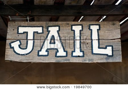 An old-fashioned Western jail sign