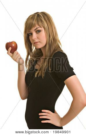 A pretty young woman tempting with a red apple