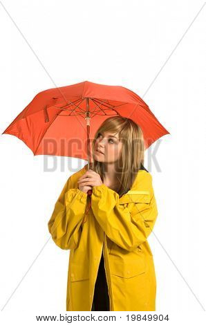A pretty young woman, isolated against a white background, wears a bright yellow raincoat and holds an umbrella, waiting for rain