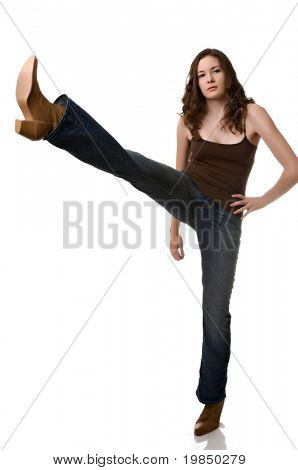 Beautiful young woman high kicks in cowboy boots
