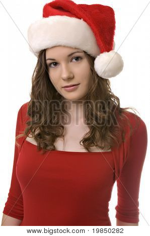 Beautiful young woman wearing Santa hat at Christmas isolated against white background