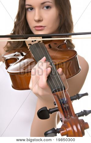 Beautiful young woman plays viola or violin isolated against white background