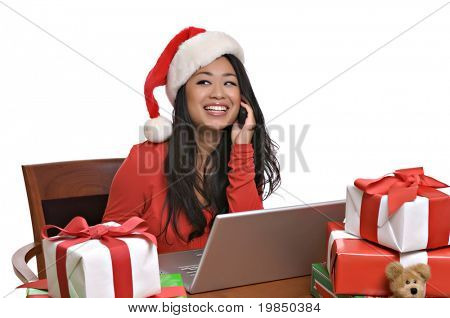 Beautiful Asian woman shops for Christmas presents online