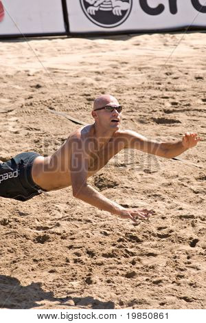 GLENDALE, AZ - SEPTEMBER 27: Olympic gold medalist Phil Dalhausser dives for ball as he competes at the AVP Best of the Beach volleyball tournament in Glendale, Arizona.
