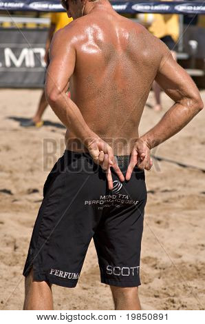 GLENDALE, AZ - SEPTEMBER 26: 1999 AVP Rookie of the Year Sean Scott signals as he wairs for the next serve at the AVP Best of the Beach volleyball tournament in Glendale, Arizona.