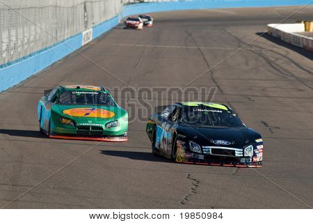 AVONDALE, AZ - NOV 7: Bobby Hamilton Jr. (25) and Morgan Shepherd (89) compete in the NASCAR Nationwide Series at Phoenix International Raceway on November 7, 2008 in Avondale, Arizona.