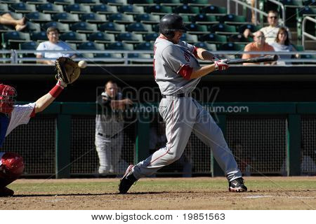 MESA, AZ - NOV 20: Mark Trumbo of the Scottsdale Scorpions swings at a pitch in the Arizona Fall League baseball game with the Mesa Solar Sox on November 20, 2008 in Mesa, Arizona.
