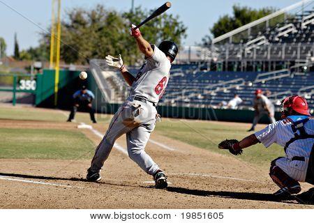 MESA, AZ - NOV 20: Chris Pettit of the Scottsdale Scorpions swings, with Lou Marson of the Mesa Solar Sox behind the plate in the Arizona Fall League game on November 20, 2008 in Mesa, Arizona.
