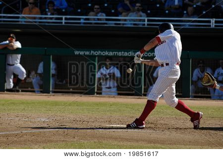 MESA, AZ - NOV 20: Jeremy Slayden of the Mesa Solar Sox hits in an Arizona Fall League baseball game between with the Scottsdale Scorpions on November 20, 2008 in Mesa, Arizona.