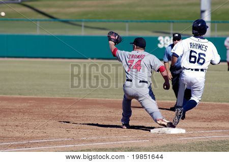 MESA, AZ - NOV 20: Will Rhymes of the Mesa Solar Sox beats throw to Scottsdale Scorpions first baseman Mark Trumbo in the Arizona Fall League game on November 20, 2008 in Mesa, Arizona