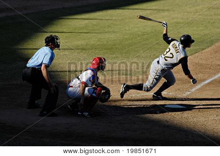MESA, AZ - NOV 20: Jamie Romak of the Scottsdale Scorpions hits with catcher Lou Marson of the Mesa Solar Sox behind the plate in the Arizona Fall League game on November 20, 2008 in Mesa, Arizona.