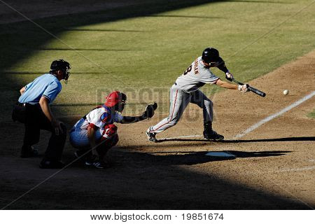 MESA, AZ - NOV 20: Kevin Frandsen of the Scottsdale Scorpions bunts with catcher Lou Marson of the Mesa Solar Sox behind the plate in the Arizona Fall League game on November 20, 2008 in Mesa, Arizona