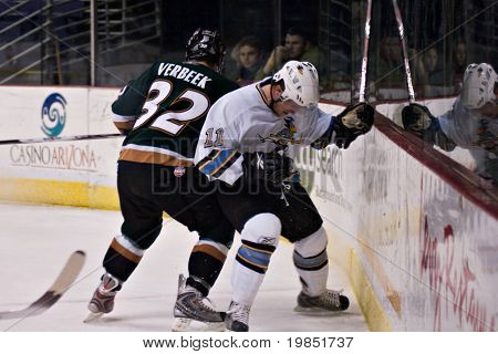 PHOENIX, AZ - DECEMBER 18: Utah Grizzlies wing Tim Verbeek (#32) checks Phoenix Roadrunners defenseman Matt Burke (#11) during the ECHL hockey game on December 18, 2008 in Phoenix, Arizona.