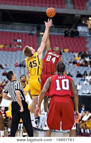 GLENDALE, AZ - DECEMBER 20: Minnesota?s Colton Iverson #45 faces Louisville?s Samardo Samuels #24 at the opening tip-off of the basketball game on December 20, 2008 in Glendale, Arizona.