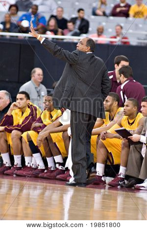 "GLENDALE, AZ - DECEMBER 20: Minnesota Gopher coach Orlando ""Tubby"" Smith gestures during the basketball game against the Louisville Cardinals on December 20, 2008 in Glendale, Arizona."