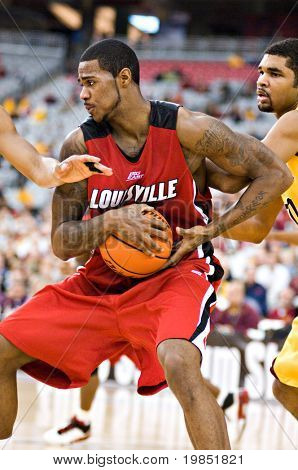 GLENDALE, AZ - DECEMBER 20: Earl Clark #5 of Louisville protects the ball as Ralph Sampson #50 of Minnesota defends in the basketball game on December 20, 2008 in Glendale, Arizona.