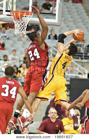 GLENDALE, AZ - DECEMBER 20: Samardo Samuels #24 of Louisville defends as Travis Busch #4 of Minnesota goes up for a layup in the basketball game on December 20, 2008 in Glendale, Arizona.