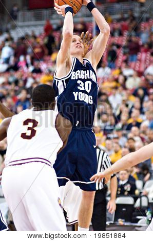 GLENDALE, AZ - DECEMBER 20: Brigham Young University forward Lee Cummard #30 puts up a jump shot in the basketball game with Arizona State University on December 20, 2008 in Glendale, Arizona.