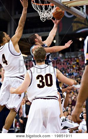 GLENDALE, AZ - DECEMBER 20: Jonathan Tavernari #45 of Brigham Young University drives for a layup past Arizona State University forward Jeff Pendergraph #4 on December 20, 2008 in Glendale, Arizona.
