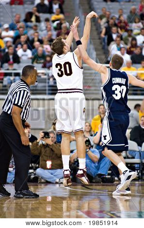 GLENDALE, AZ - DECEMBER 20: Rihards Kuksiks #30 of Arizona State University shoots over Lee Cummard #30 of Brigham Young University in the basketball  game on December 20, 2008 in Glendale, Arizona.