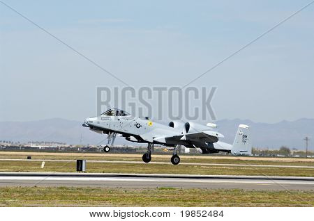 """GLENDALE, AZ - MARCH 21: A U.S. Air Force A-10 Thunderbolt lands on the runway at the biennial air show (""""Thunder in the Desert"""") at Luke Air Force Base on March 21, 2009 in Glendale, AZ."""